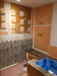 foam building panels were used on open stud walls while waterproof membrane was applied over existing wallboard
