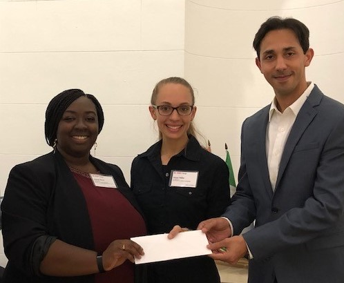 Accompanied by Ankit Ghasi (right), a David Allen Company Leader, presents the 2019-2020 David Allen Company Scholarship to Architectural Students, Jasmyn Byrd (on right) and Maya Miller.