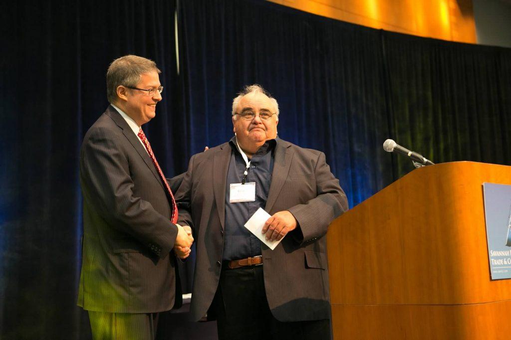 Photo of Dave Gobis receiving an award