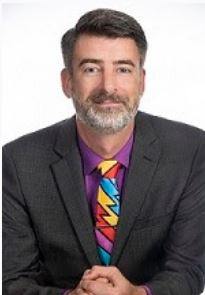 bearded man with colorful tie