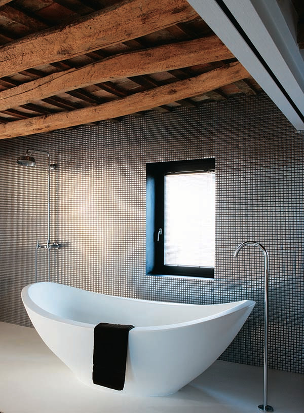 bathtub with square metal metallic wall