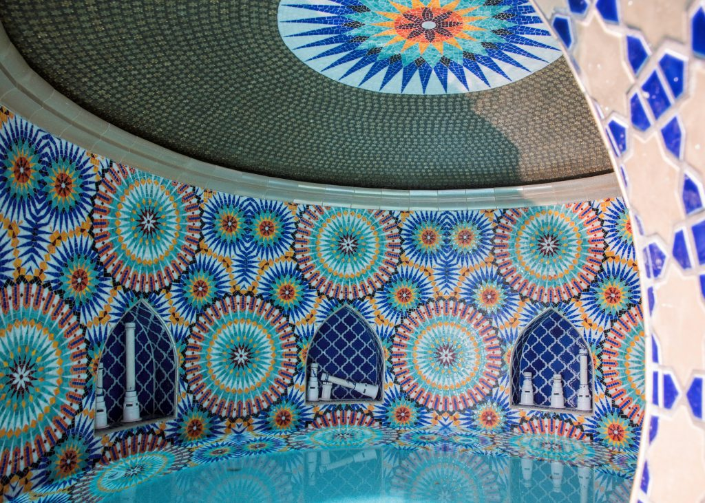Pool grotto with colorful mosaics