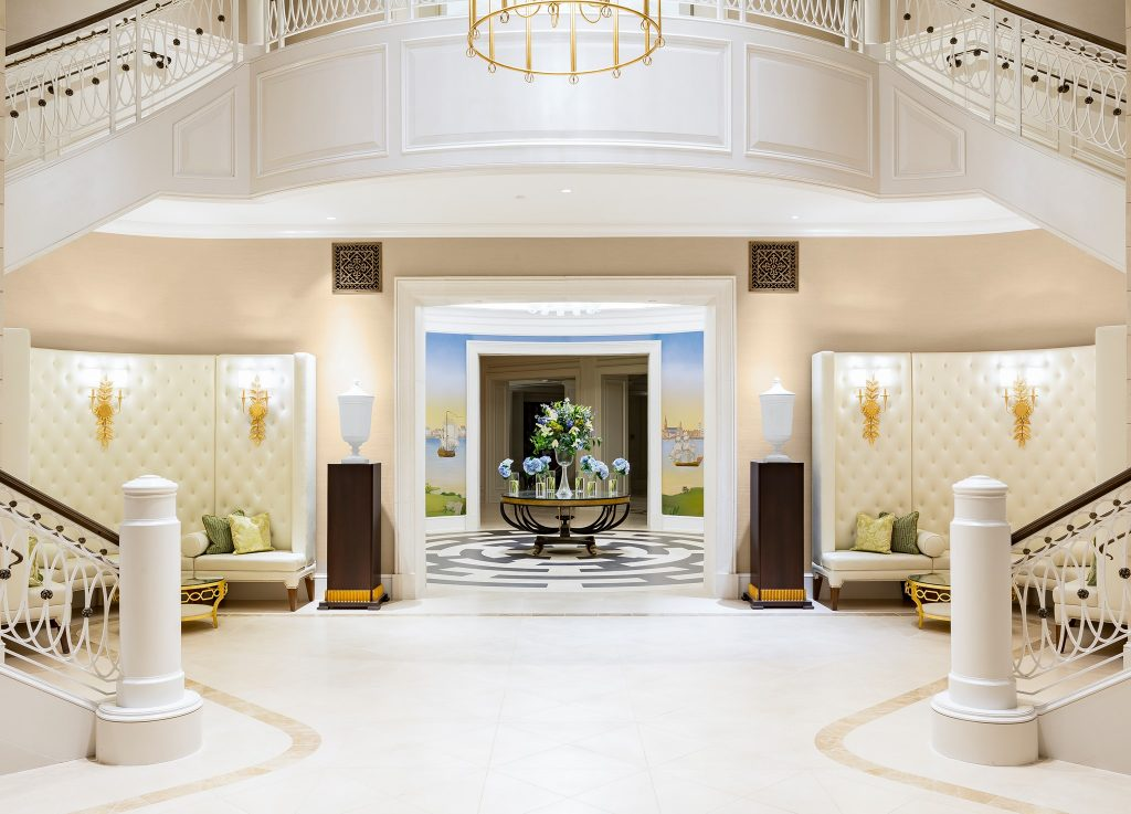 hotel lobby with medallion and grand staircase