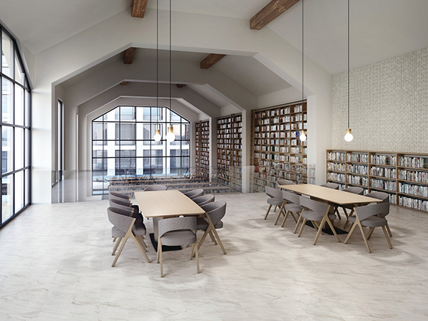 Library with two tables. Photo features Defend™ – Marble Look Iconic 12 x 24 matte on the floor.