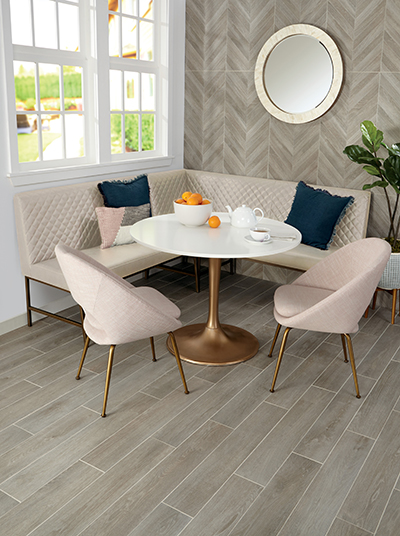 Photo features Defend™ – Wood Look Smoke 6 x 36 on the floor. in kitchen nook